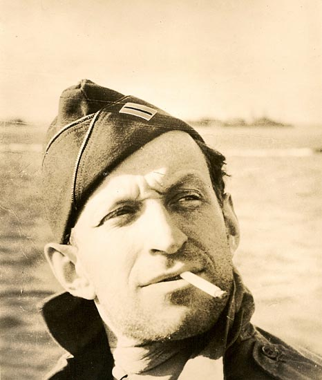 Army photo of Garson Kanin smoking a cigarette