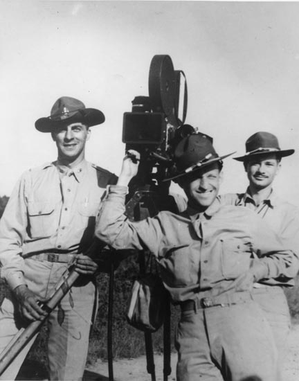 Army Photo of Garson Kanin with a camera - 1945 - No Credit